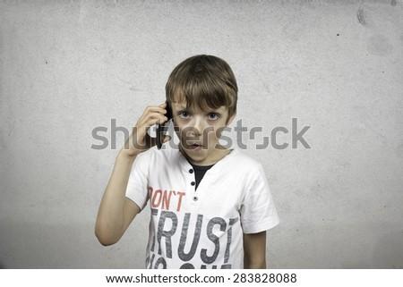 Boy talking on mobile phone. - stock photo