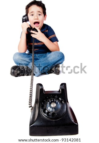 Boy talking on the phone - isolated over a white background