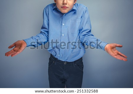 boy teenager of European appearance brown hair threw up his hands in disbelief unknown - stock photo