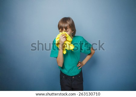 Boy, teenager, twelve years  in a green t-shirt, handkerchief - stock photo