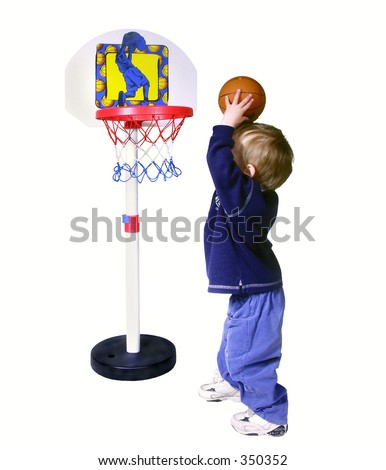 boy throwing a basket ball