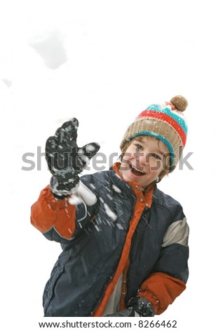 Boy Throwing a SnowBall - stock photo