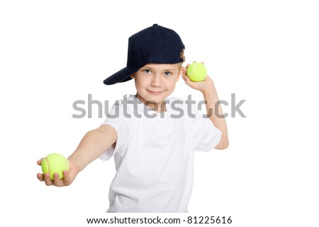 Boy throwing tennis balls. Isolation on white. - stock photo
