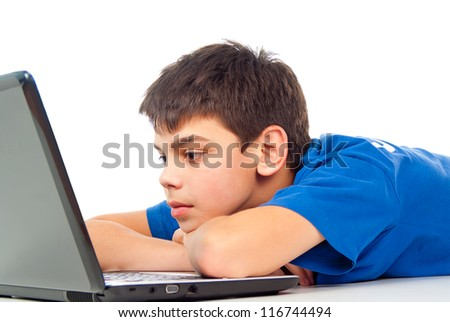 boy tired for a laptop to play video games - stock photo