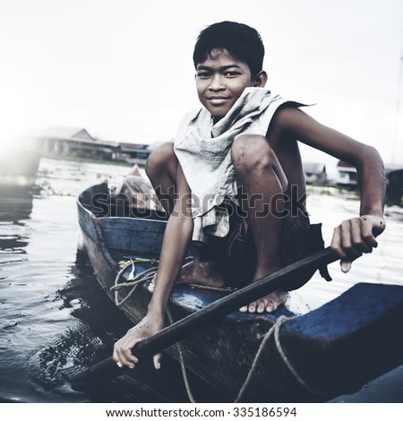 Boy Traveling Boat Floating Village Cambodian Vessel Concept - stock photo