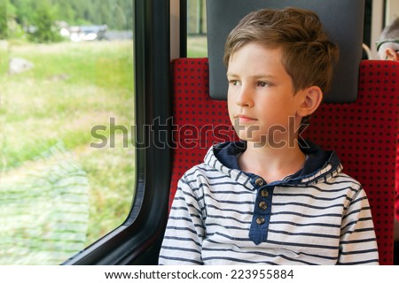 boy travels by train at the window - stock photo