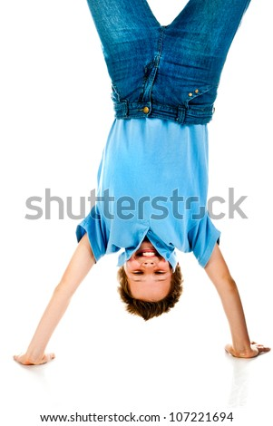 boy upside down on a white background - stock photo