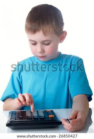 Boy using a calculator for his homework - stock photo