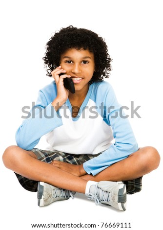 Boy using a mobile phone isolated over white - stock photo