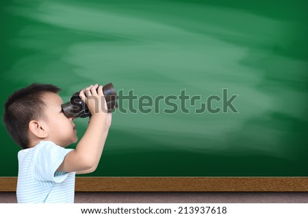 Boy using binoculars with green chalk board