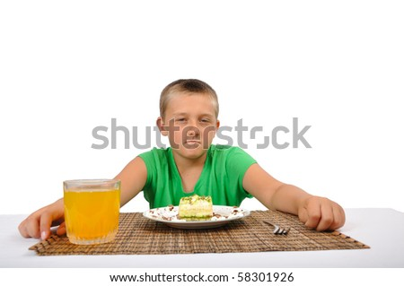 boy want to eat a dessert with fork, isolated on white - stock photo