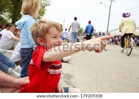 Boy watching a parade,  - stock photo