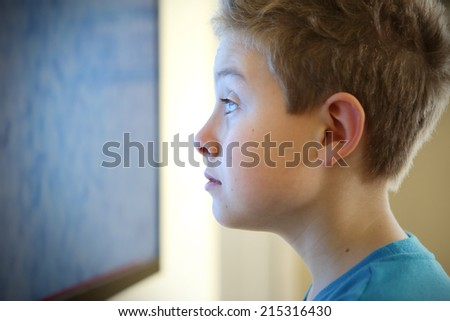 Boy watching television with noise - stock photo