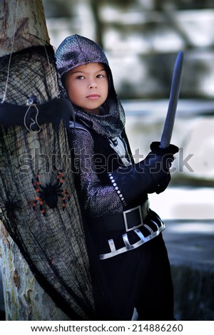 Boy wearing ancient knight Halloween costume