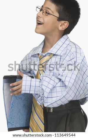 Boy wearing oversized clothes and holding a file - stock photo