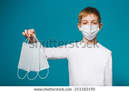 Boy wearing protection mask suggesting masks