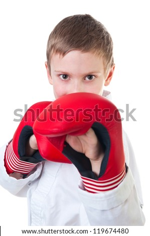 Boy wearing tae kwon do uniform and boxing gloves - stock photo