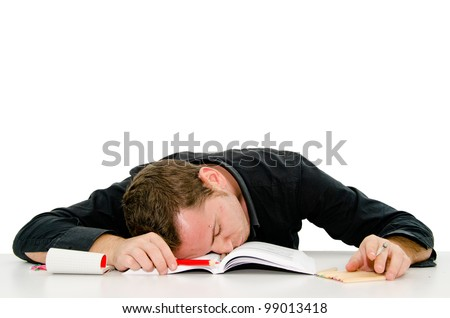 boy who sleeps on the books - stock photo