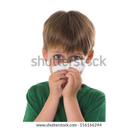 boy wipes a nose a napkin - stock photo