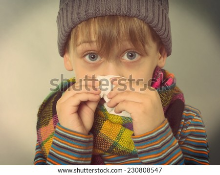 boy wiping his nose