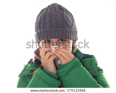 boy wiping his nose in the winter clothes