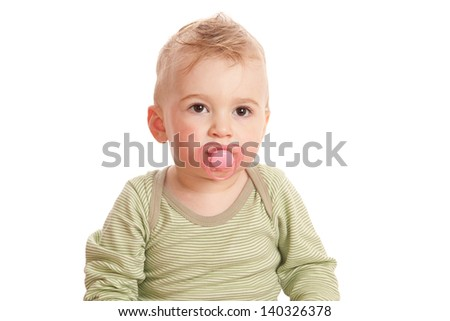 Boy with a baby's dummy on white background. Studio shot.