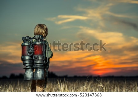 Boy with a backpack at sunset