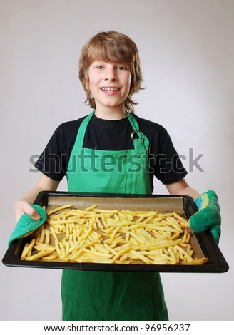 boy with a baking tray full with french fries