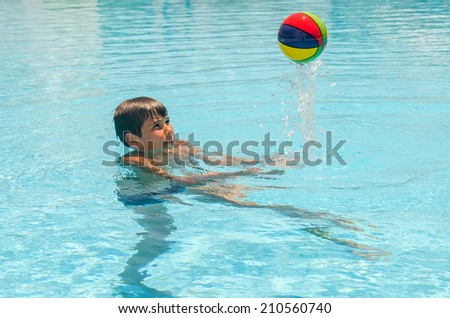 Boy with a ball in the pool. Photo for microstock - stock photo