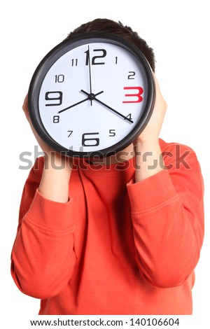 boy with a big clock isolated on white background - stock photo