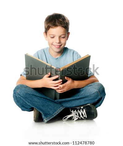 Boy with a book on a white background - stock photo