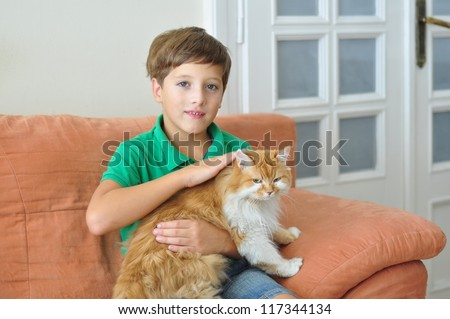 Boy with a cat - stock photo