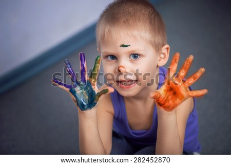 boy with a colored palms - stock photo