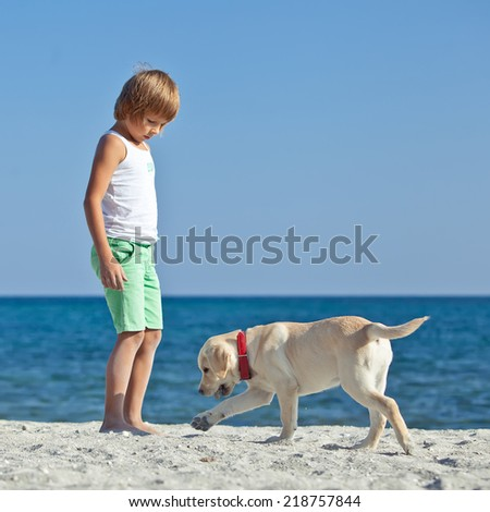 Boy with a dog on the nature - stock photo