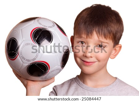 Boy with a football isolated on white. - stock photo