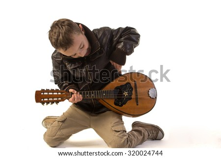 boy with a guitar   - stock photo