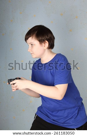 Boy with a joystick playing computer game - stock photo