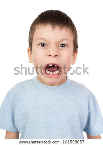 boy with a lost tooth grimacing