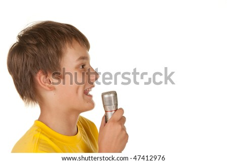 boy with a microphone doing karaoke on white - stock photo