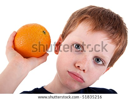 boy with a orange,  isolated on white background. Studio shot