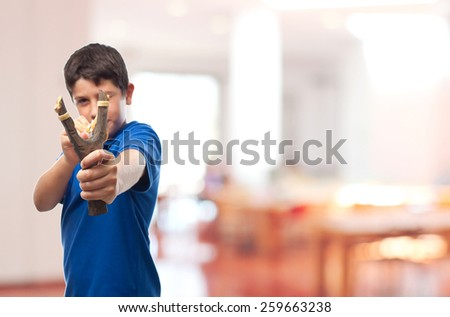 boy with a slingshot in school - stock photo