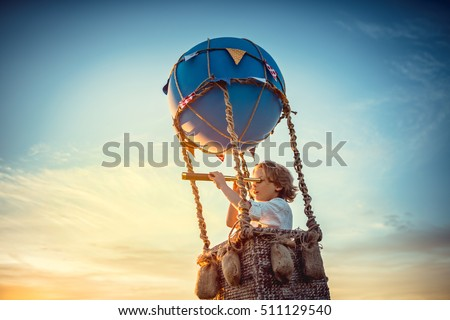 Boy with a spyglass on a balloon