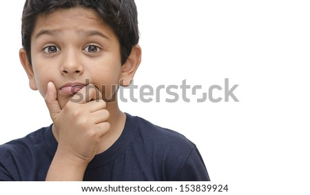 Boy with a surprise expression. - stock photo