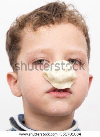 boy with a test on the nose