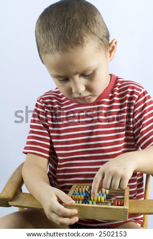 boy with abacus - stock photo