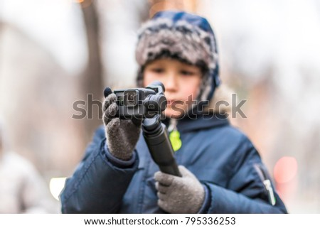 Boy with action camera in winter Vienna