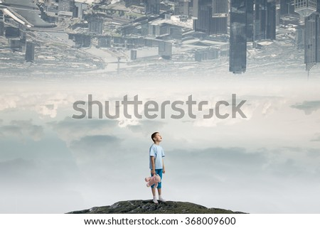 Boy with bear toy - stock photo