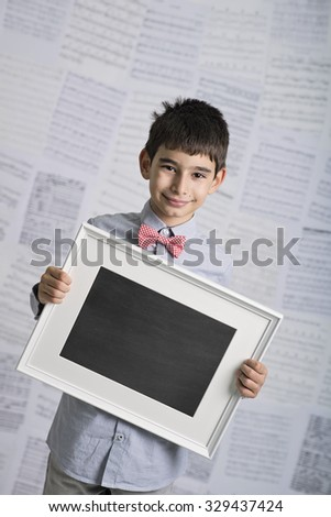 Boy with billboard in hands for Christmas - stock photo