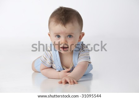 Boy with blue eyes on white