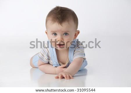 Boy with blue eyes on white - stock photo